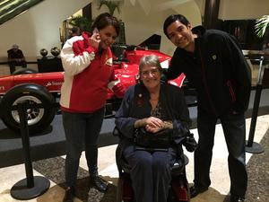 Sal Brinton with members of the Ferrari F1 team